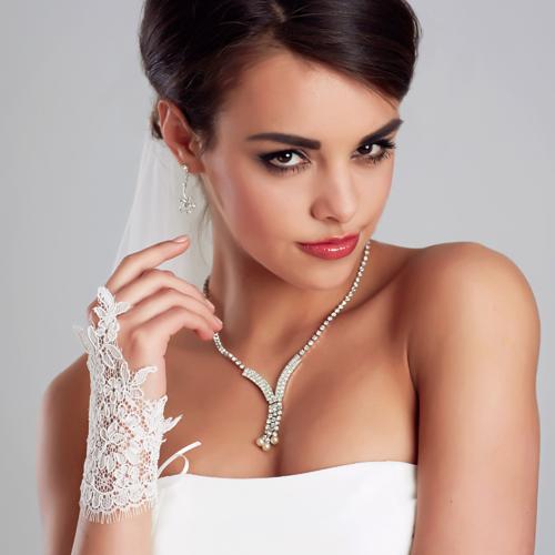 Brauthandschuhe 'Tya' aus Spitze - creme